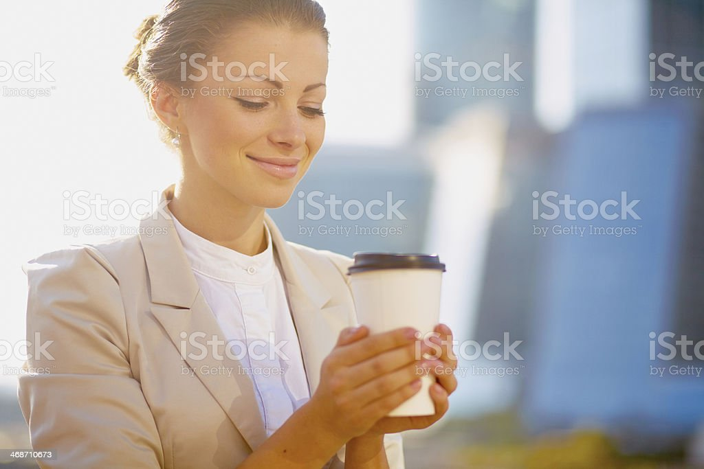Portrait of cute young business woman outdoor with coffee cup royalty-free stock photo