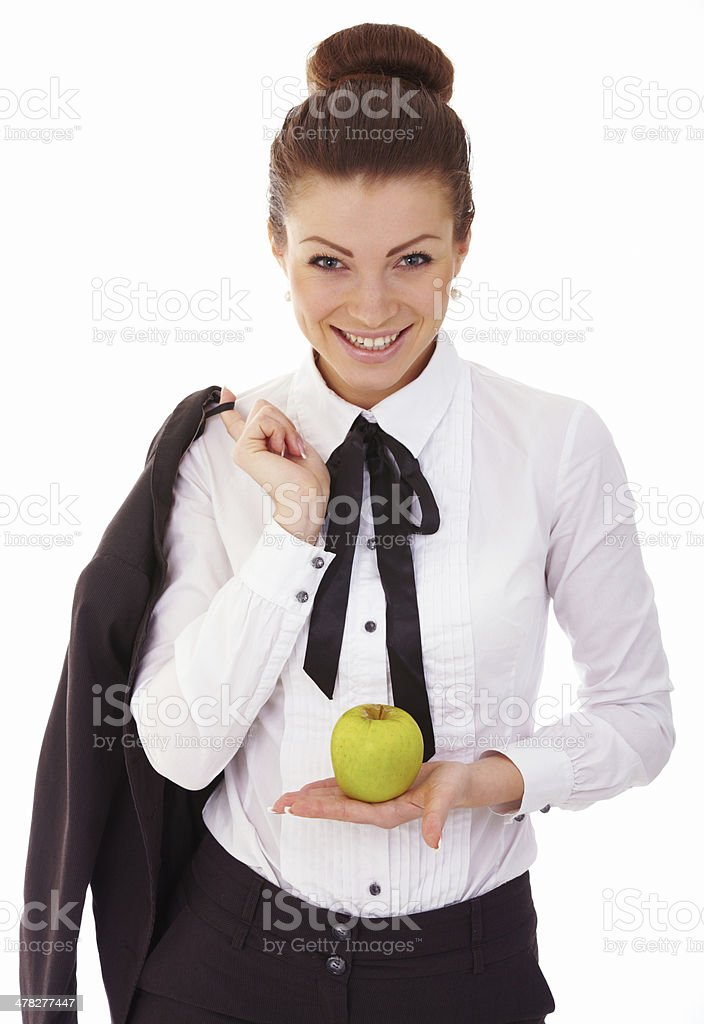 Portrait of cute young business woman with apple stock photo