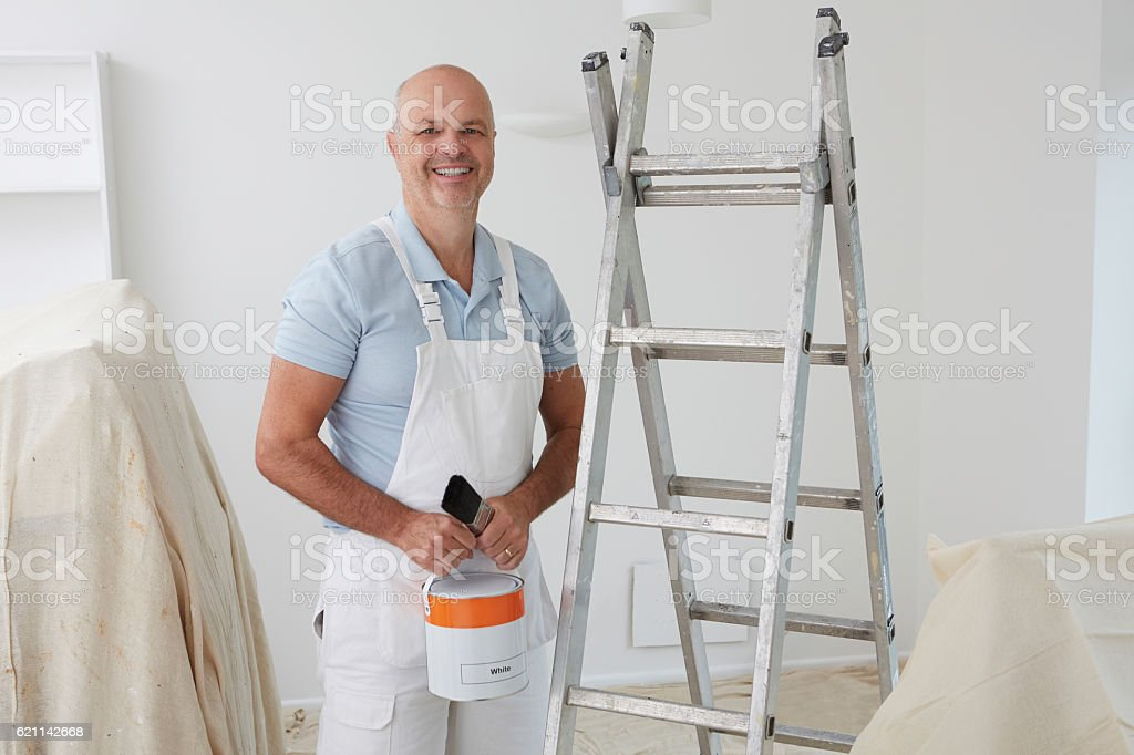 Portrait Of Decorator Painting Room stock photo