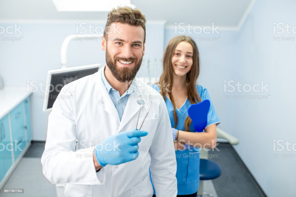 Portrait of dental team at the office stock photo