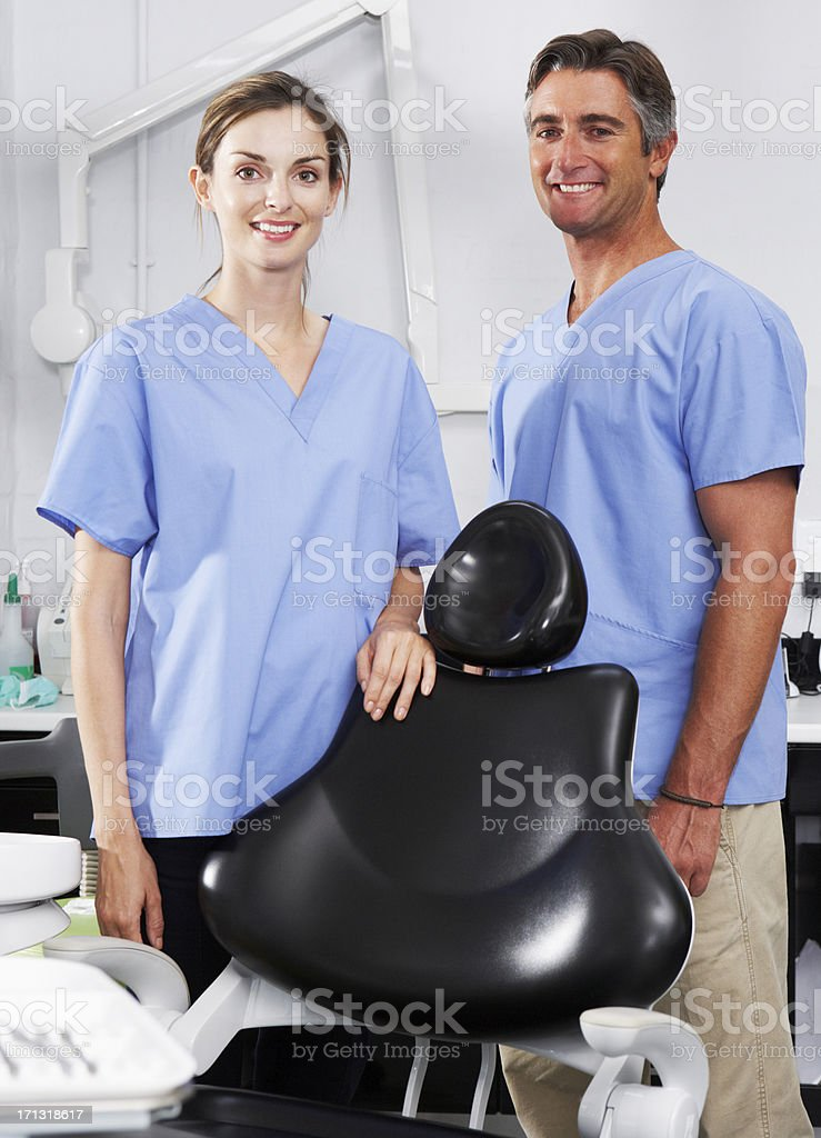 Portrait Of Dentist And Nurse In Surgery royalty-free stock photo