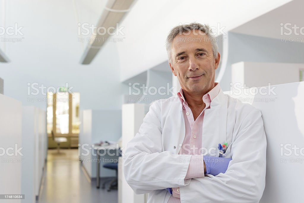 Portrait of Dentist in his office stock photo