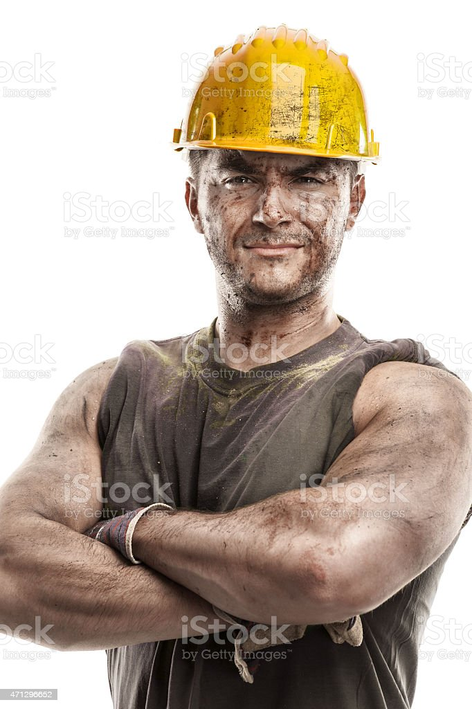 portrait of dirty worker with helmet crossed arms stock photo