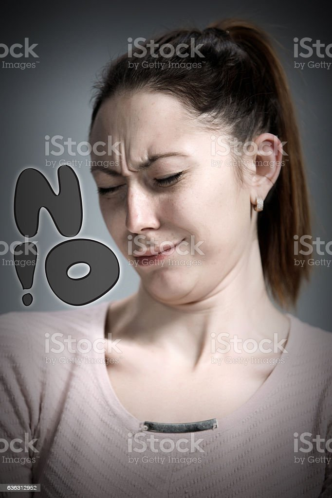 portrait of disgusted woman stock photo