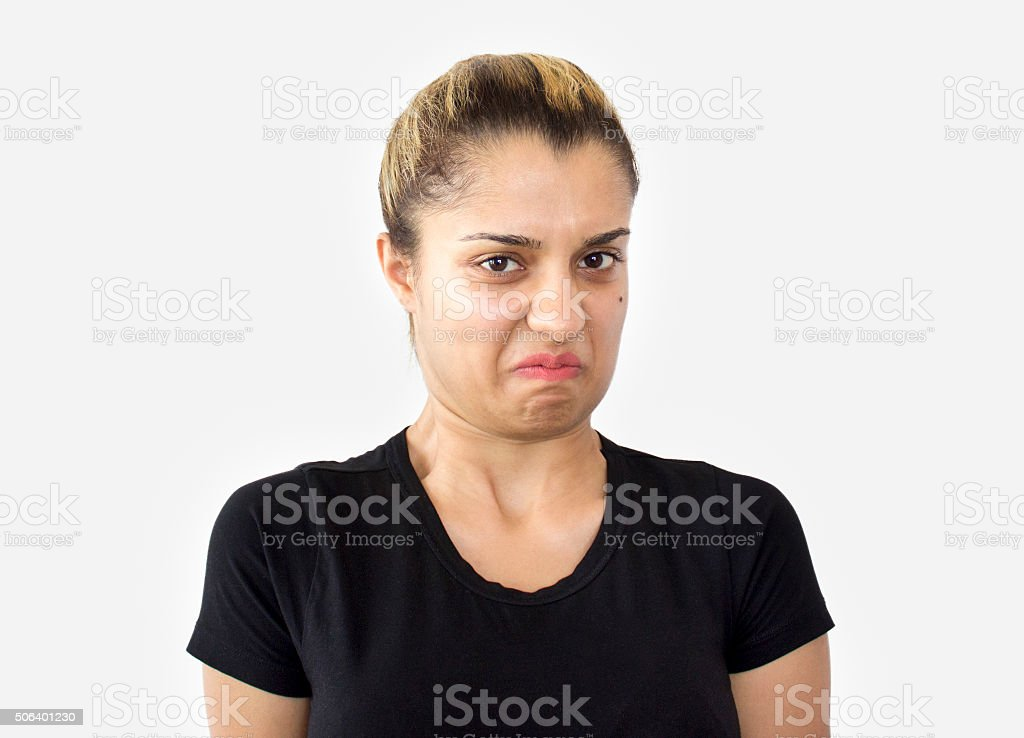 Portrait of disgusted young woman isolated on white stock photo