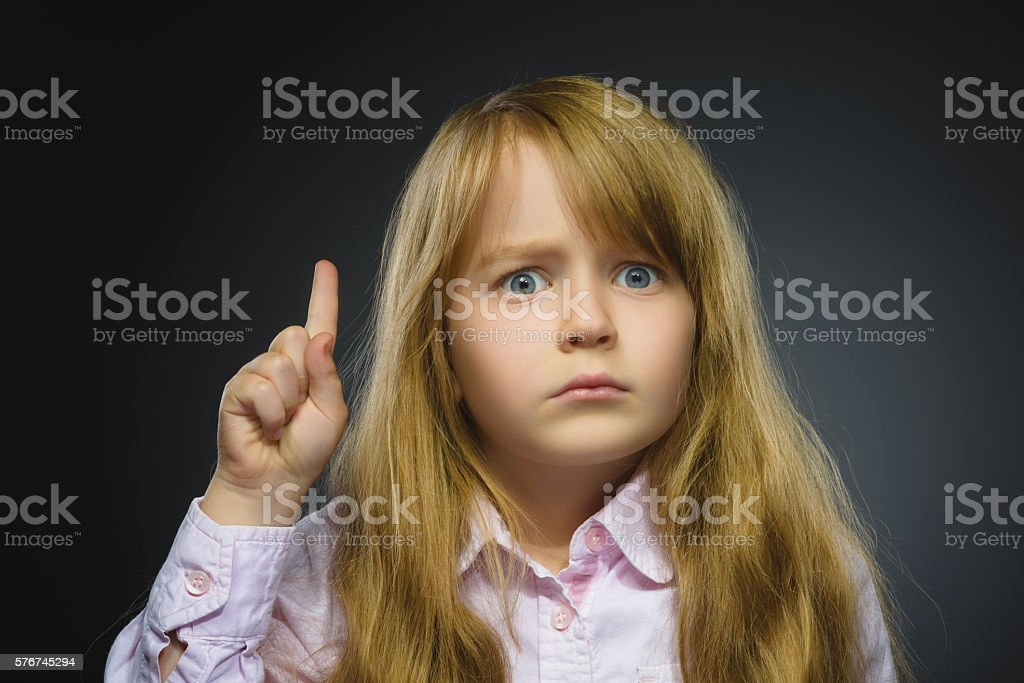 Portrait of displeased angry girl with threatens finger isolated on stock photo