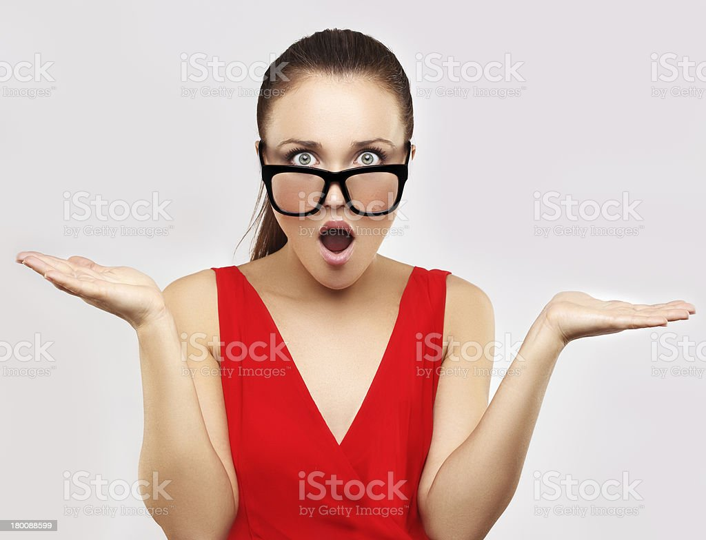 Portrait of dissatisfied young woman talking and gesturing royalty-free stock photo
