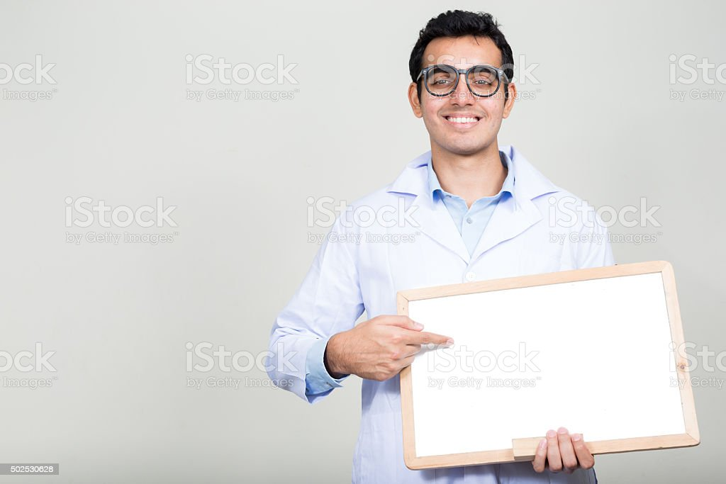 Portrait of doctor holding empty white board stock photo