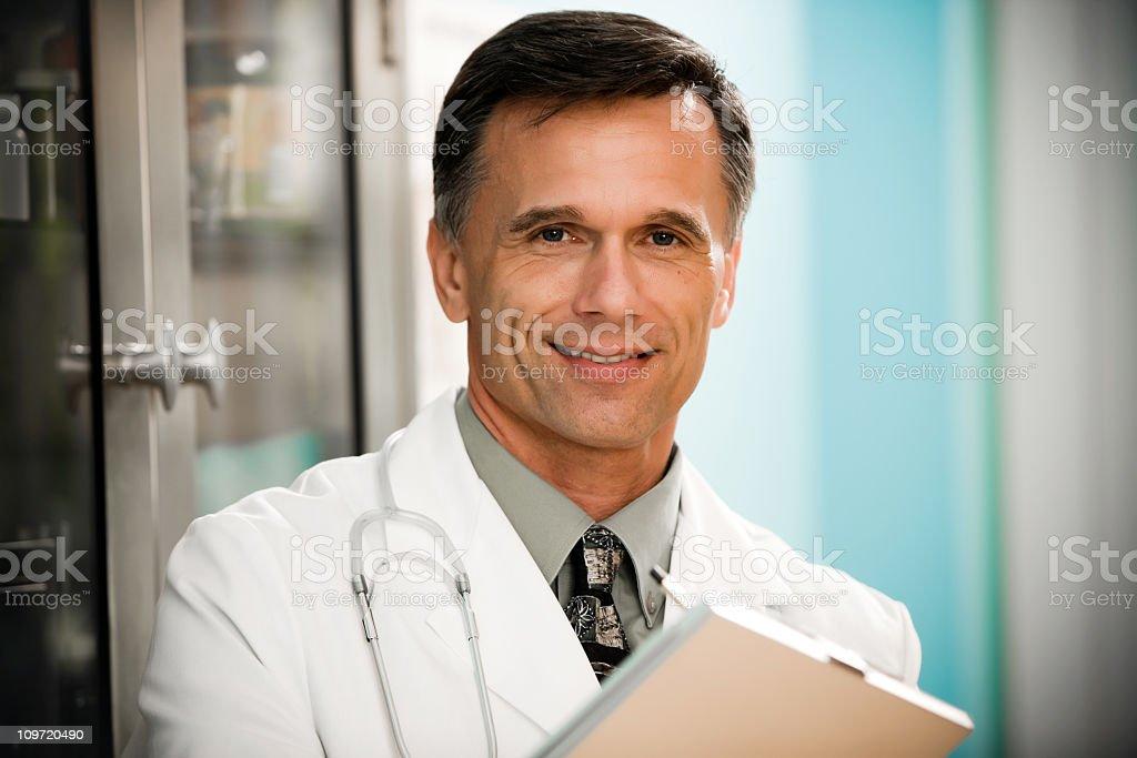 Portrait of Doctor in Exam Room stock photo