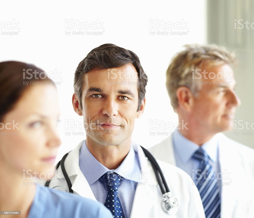 Portrait of doctor standing with his colleagues royalty-free stock photo