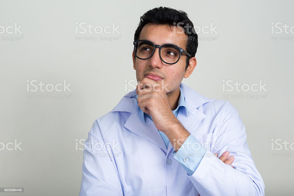 Portrait of doctor thinking stock photo