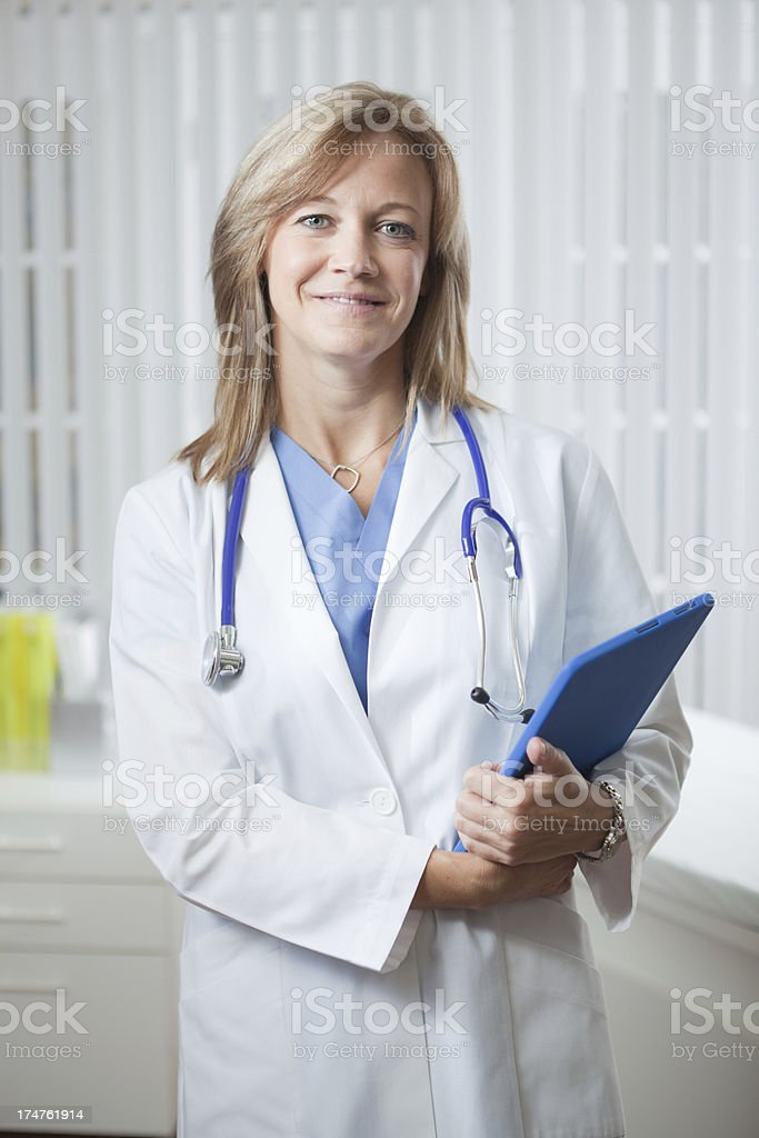 Portrait of Doctor with Tablet Computer in Clinic Vt royalty-free stock photo