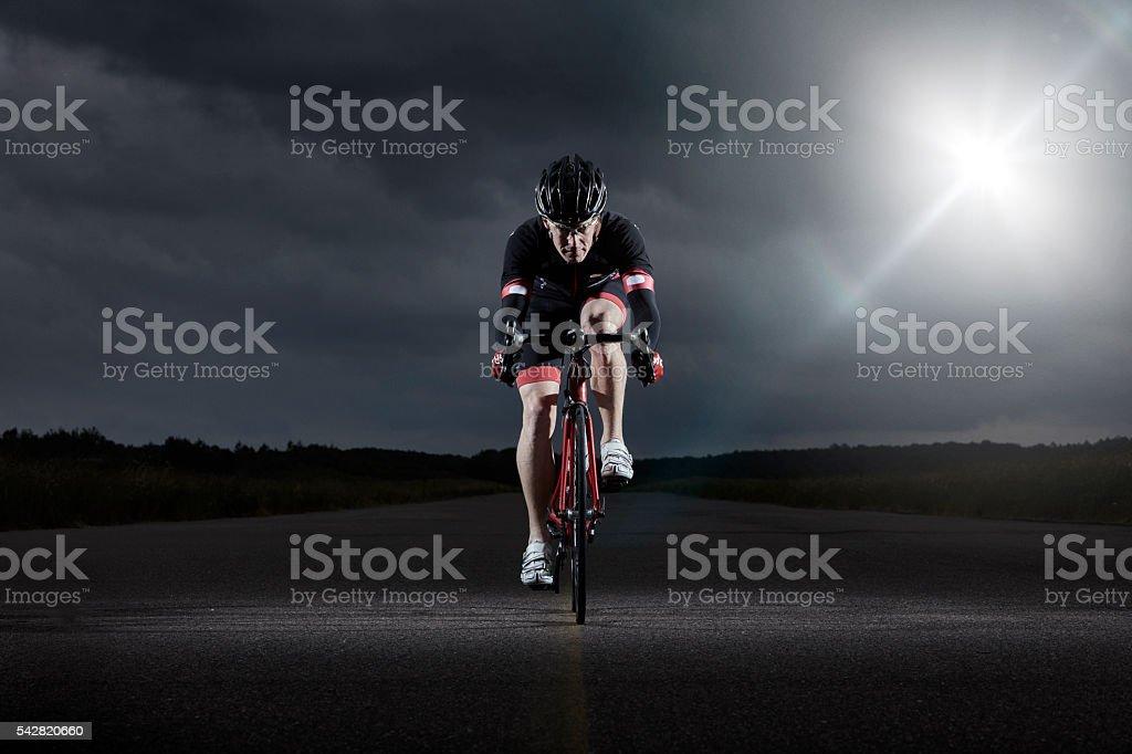Portrait of driving racer biker stock photo