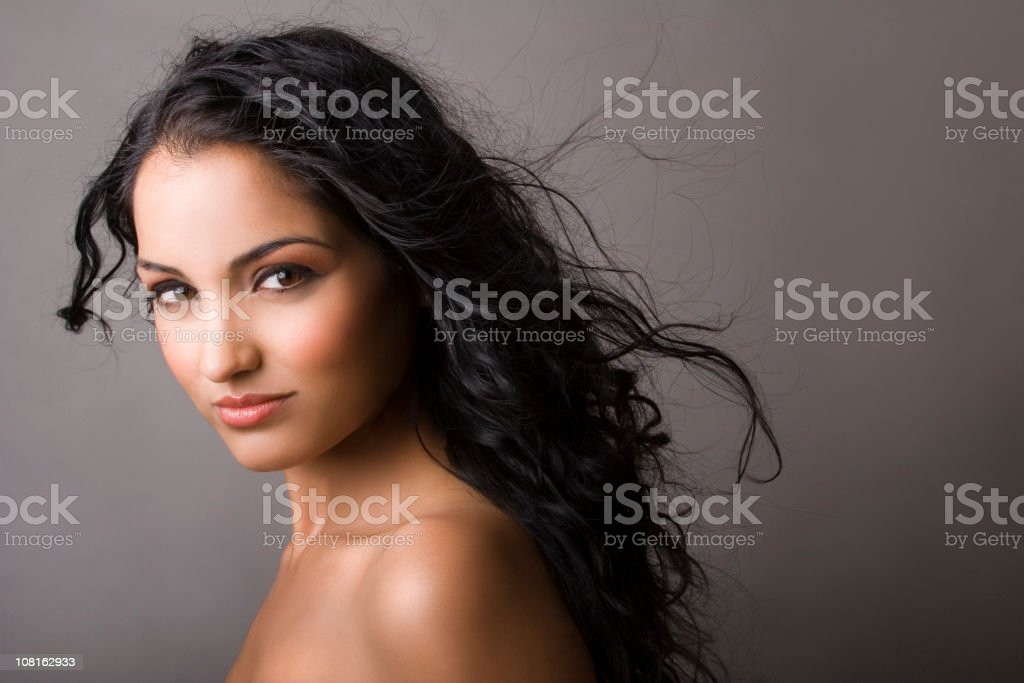 Portrait of East Indian Woman on Gray Background royalty-free stock photo