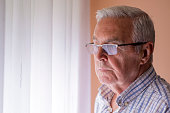 Portrait of Elderly man lost in thought, Lonely senior man