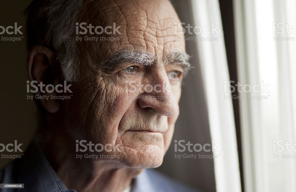 Portrait of Elderly man lost in thought stock photo