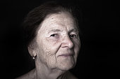 Portrait of elderly woman. Dreaminess. Toned