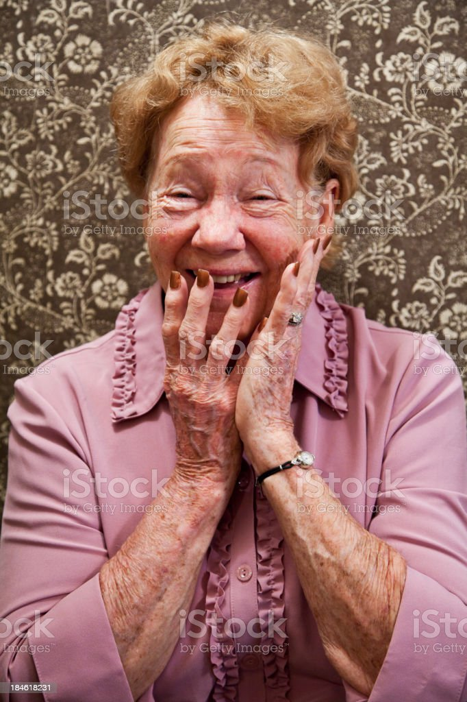 Portrait of elderly woman laughing stock photo