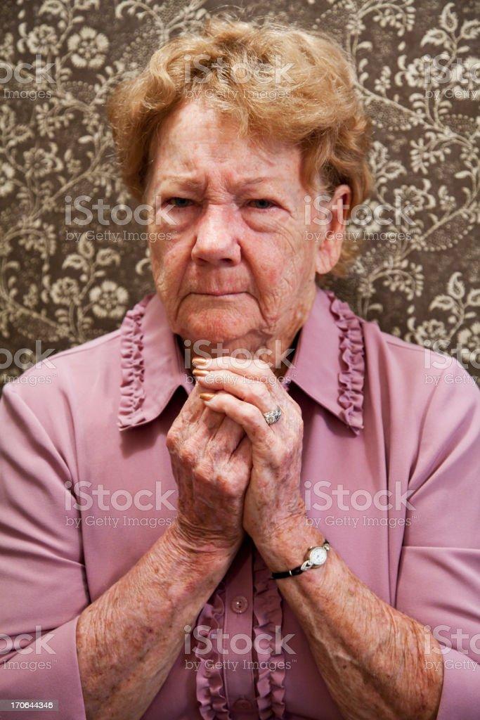 Portrait of elderly woman looking annoyed stock photo