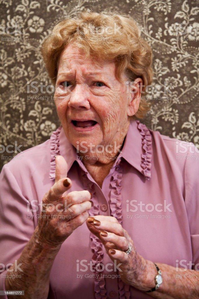 Portrait of elderly woman looking upset stock photo
