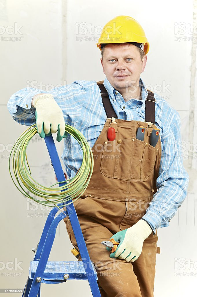 Portrait of Electrician with wire equipment royalty-free stock photo