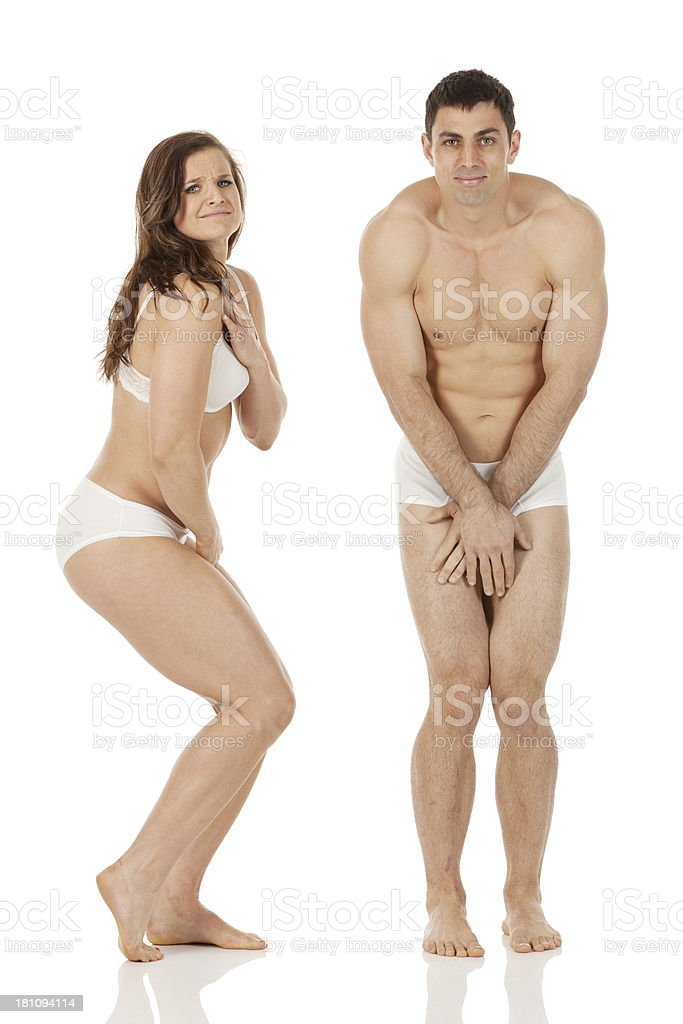 Portrait of embarrassed couple in undergarments royalty-free stock photo