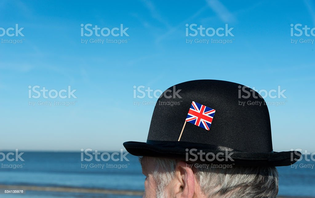 portrait of Englishman standing on the beach, overlooking the sea stock photo