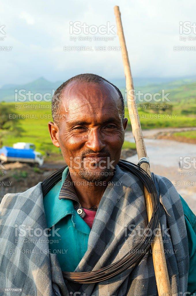 Portrait of Ethiopian man in rural landscape stock photo
