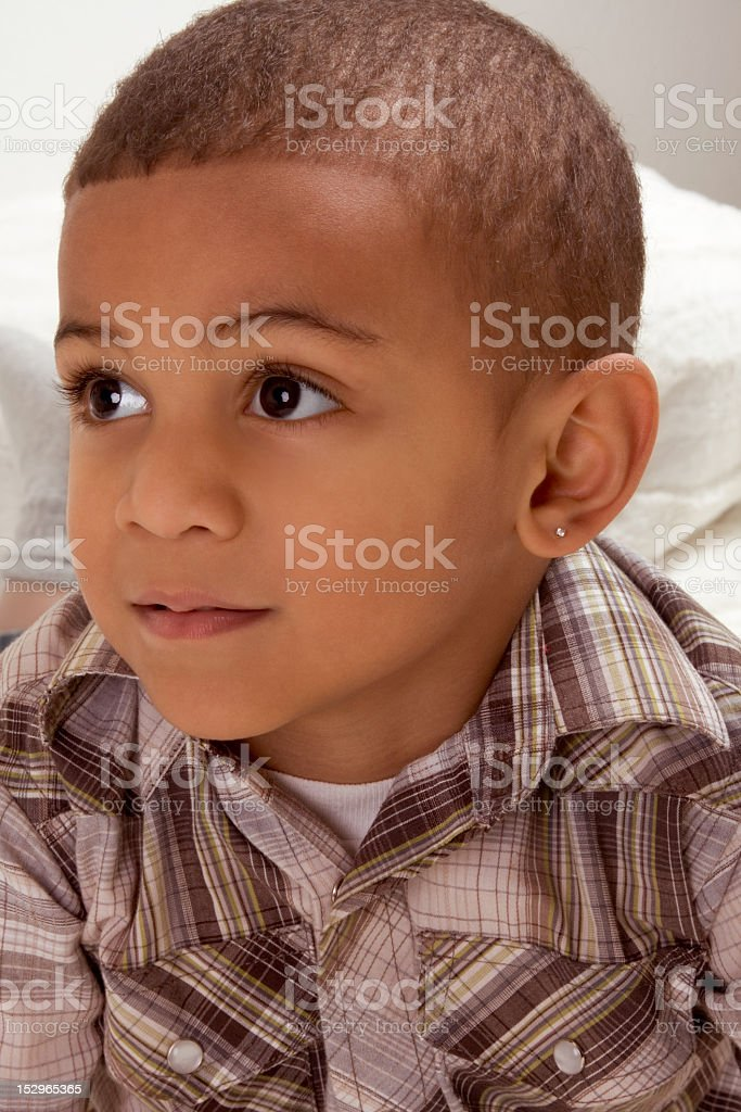 Portrait of ethnic Young little boy in checkered shirt royalty-free stock photo