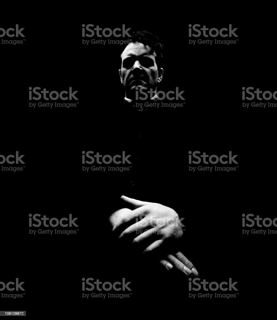 Portrait of Evil Looking Priest, Low Key Toned royalty-free stock photo