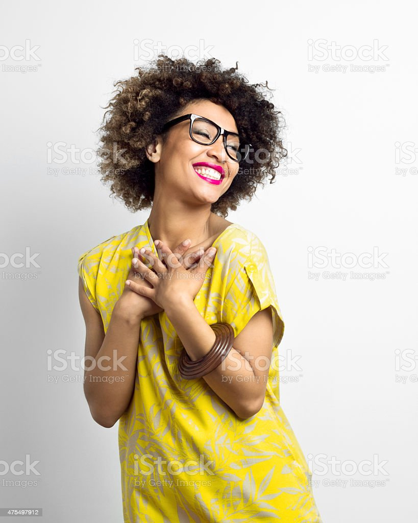 Portrait of excited Afro American Young Woman stock photo