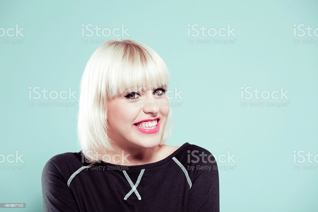 Portrait of excited blonde young woman wearing black jumper stock photo