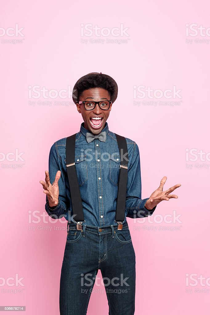 Portrait of excited, fashionable afro american guy stock photo
