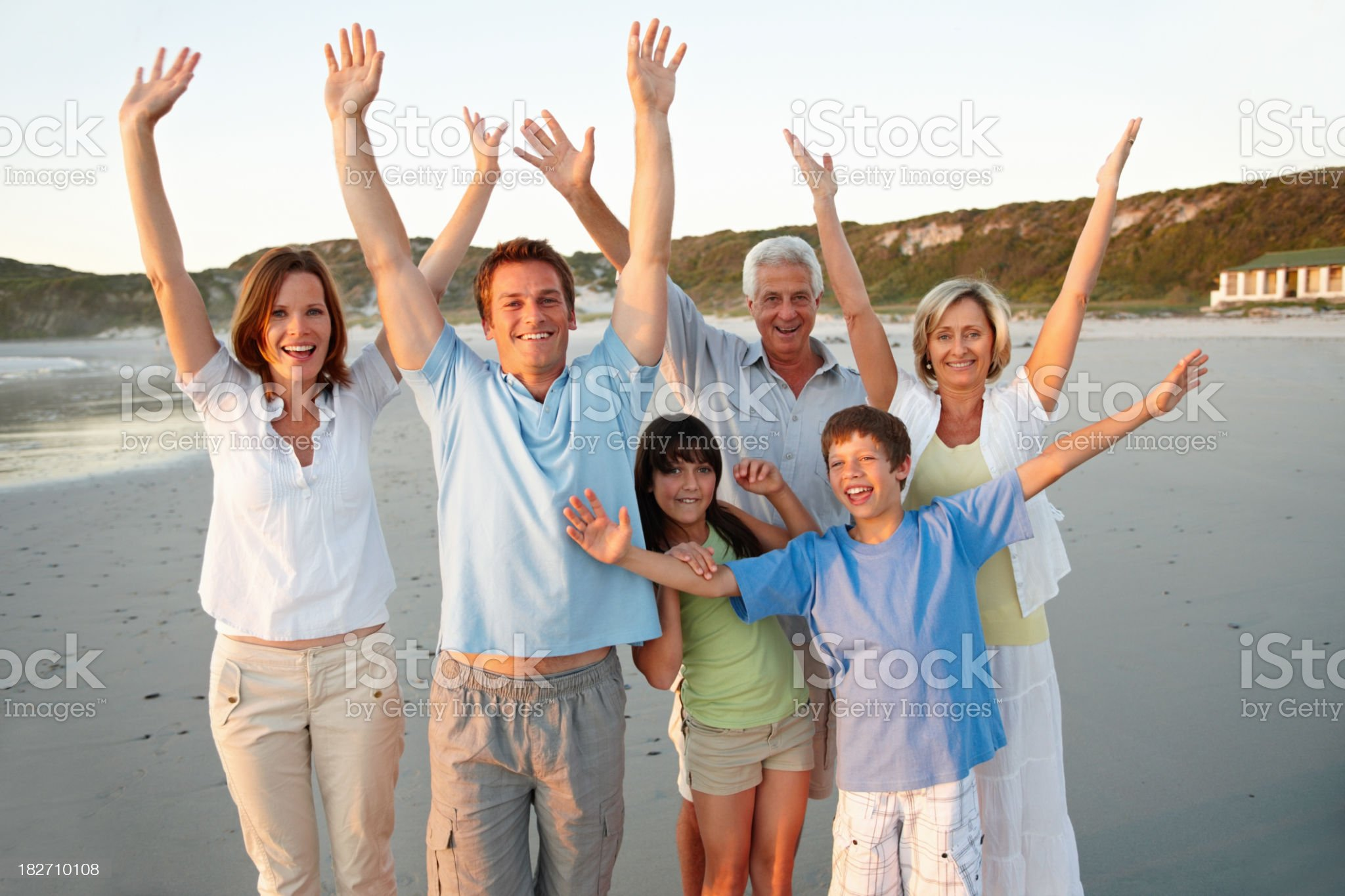 Portrait of excited three generational family enjoying on beach royalty-free stock photo