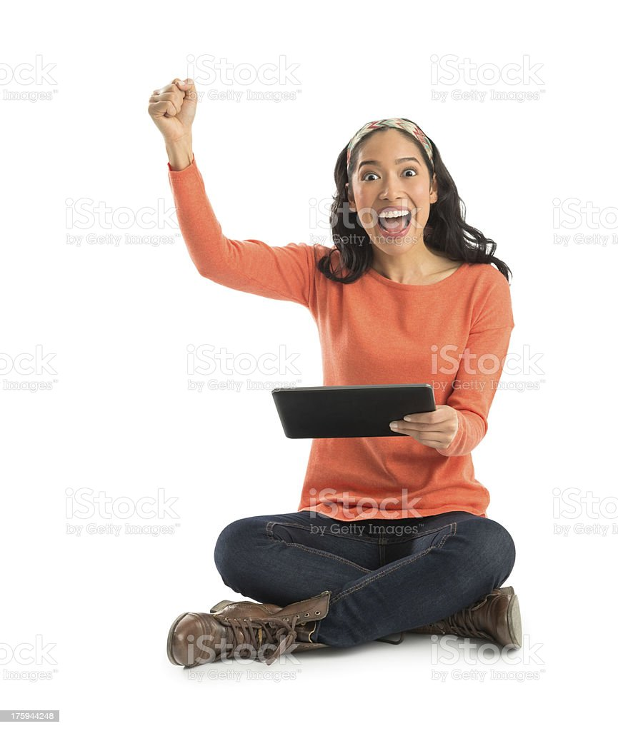Portrait Of Excited Young Woman Holding Digital Tablet royalty-free stock photo