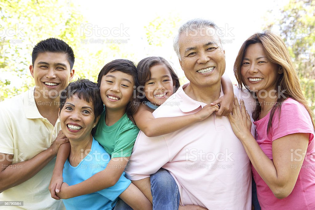 Portrait Of Extended Family Group In Park stock photo