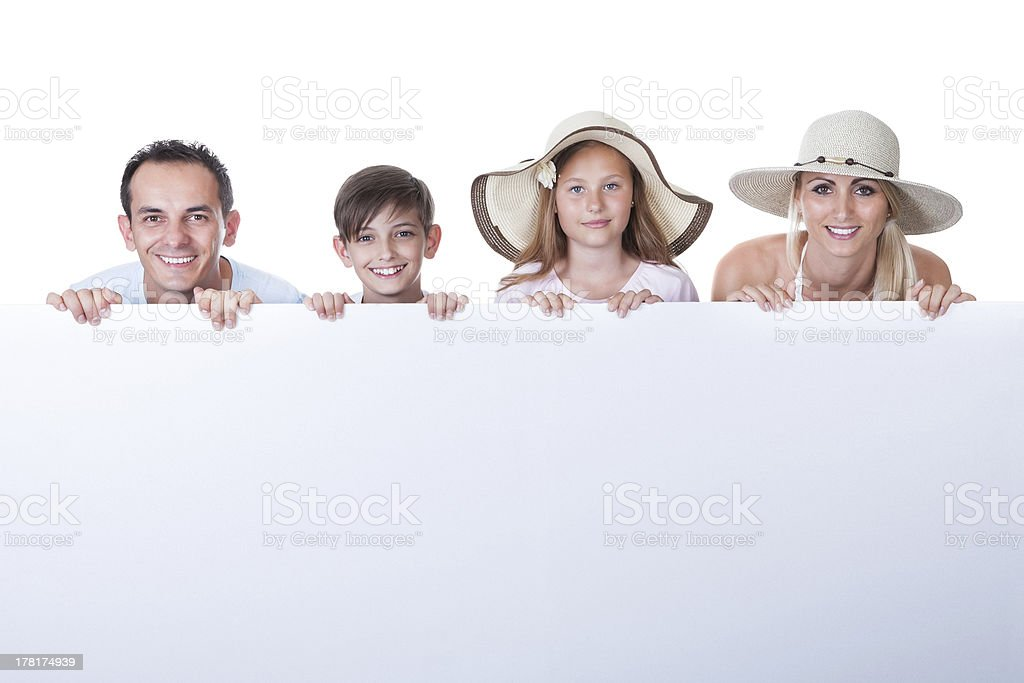 Portrait Of Family Behind Blank Board royalty-free stock photo