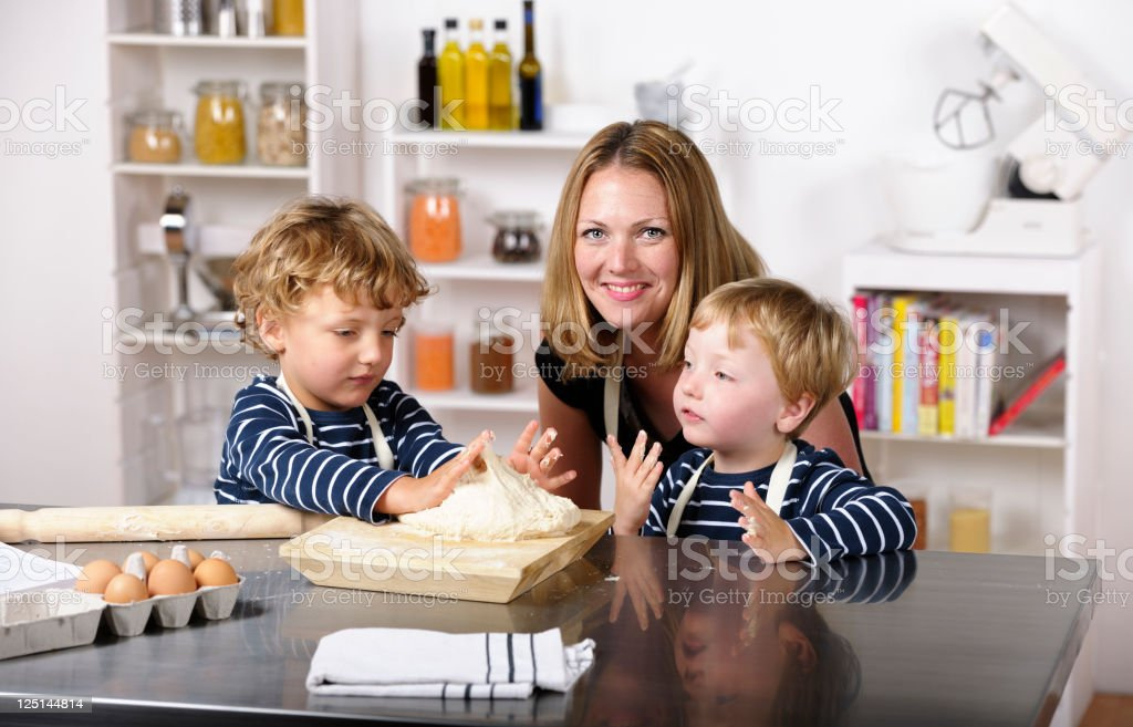 Portrait Of Family Enjoying Home Cooking stock photo