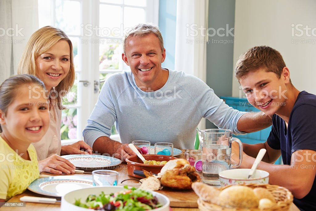 Portrait Of Family Enjoying Meal At Home Together stock photo