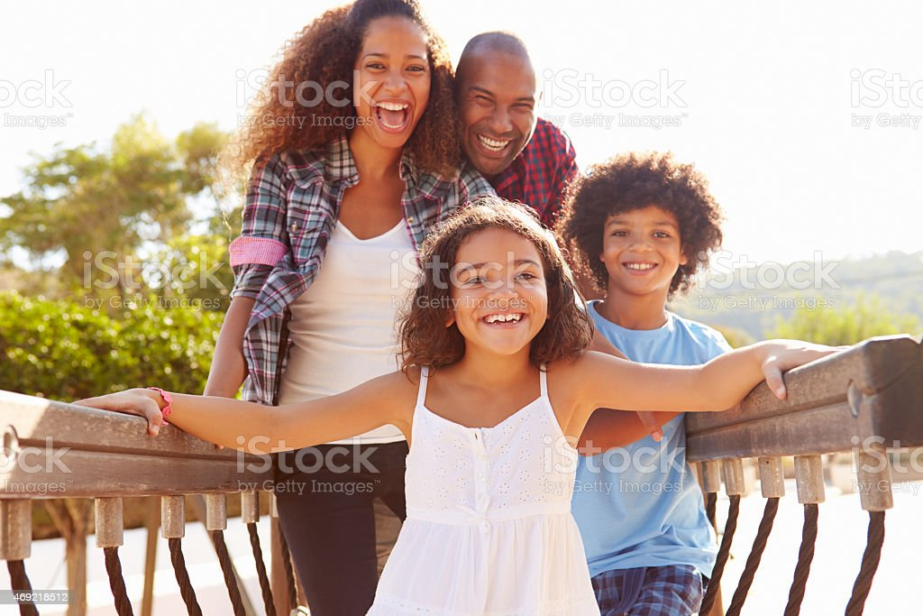 Portrait Of Family On Playground Climbing Frame stock photo