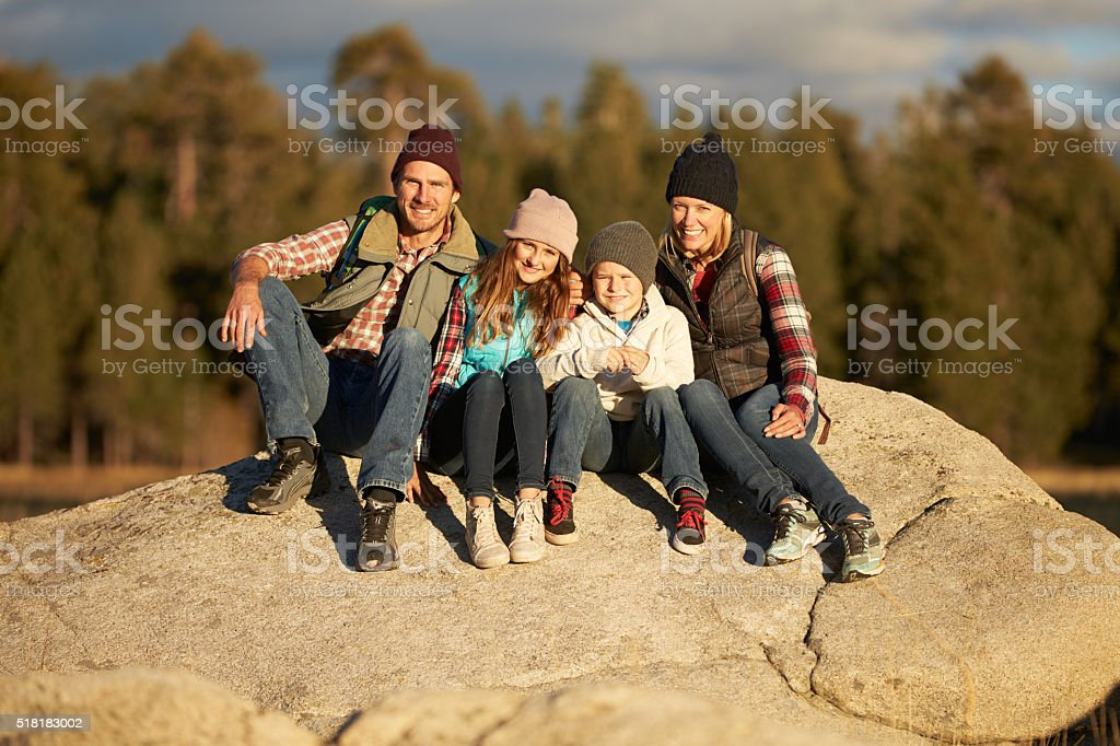 Portrait of Family sitting on rocky outcrop, California, USA stock photo