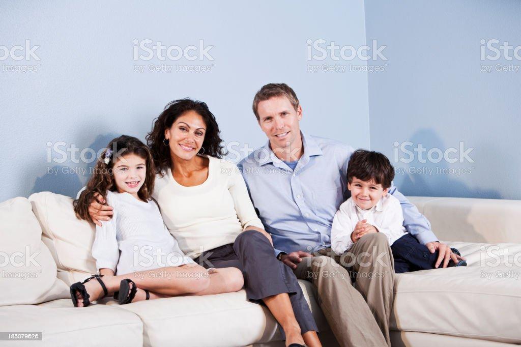Portrait of family sitting on sofa royalty-free stock photo