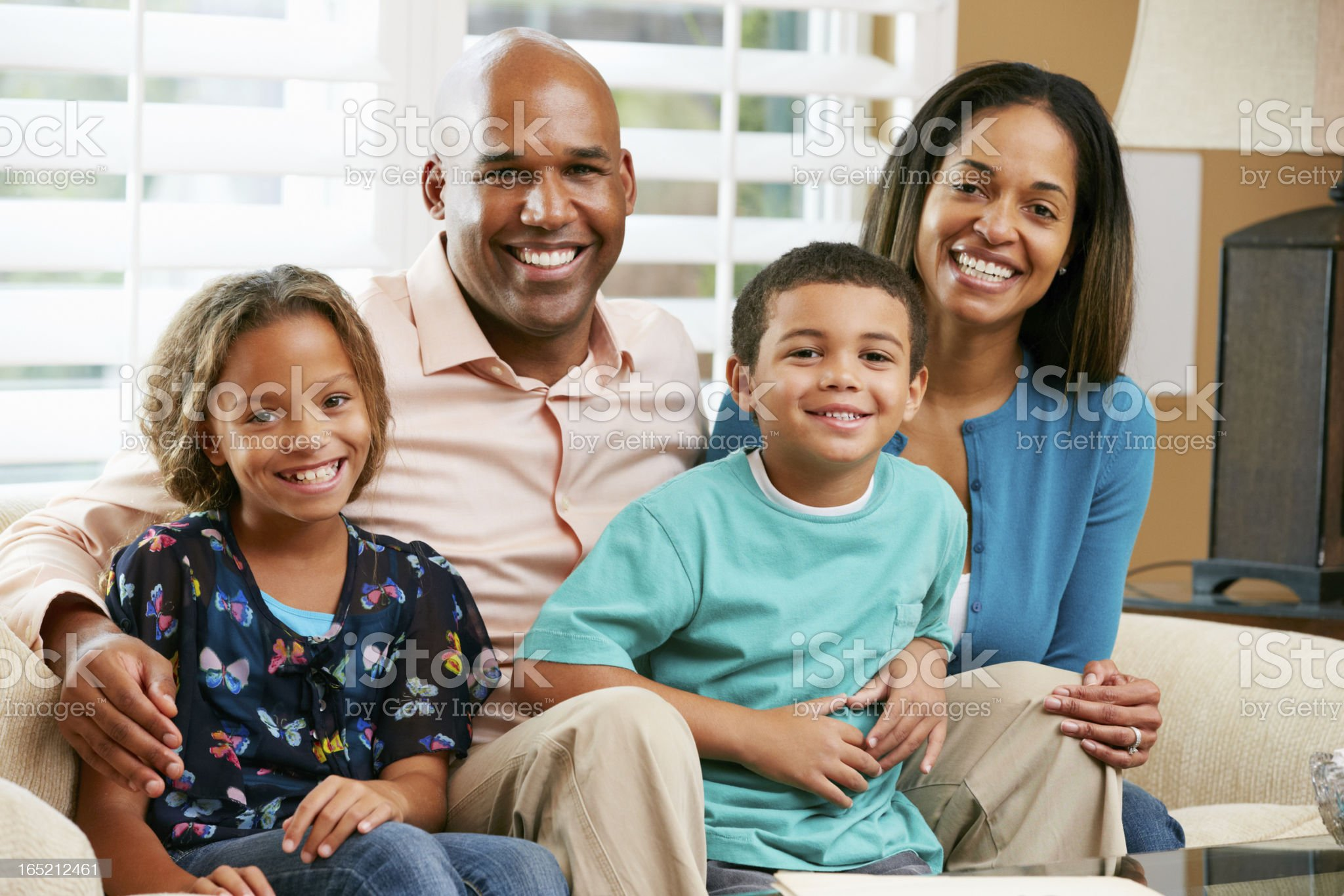 Portrait Of Family Sitting On Sofa Together royalty-free stock photo