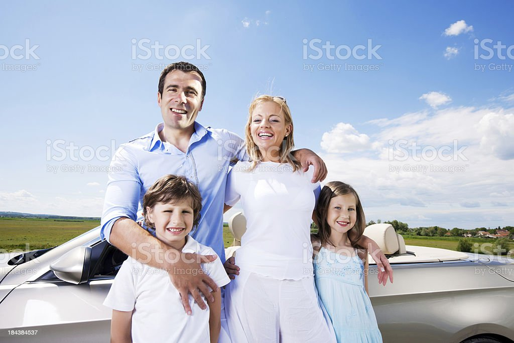 Portrait of family standing near Convertible car. royalty-free stock photo