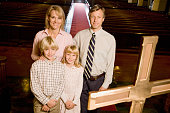 Portrait of family standing on altar in church