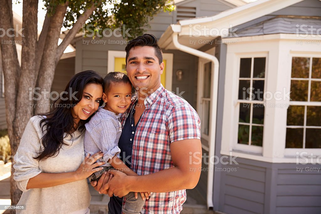 Portrait Of Family Standing Outside Home stock photo