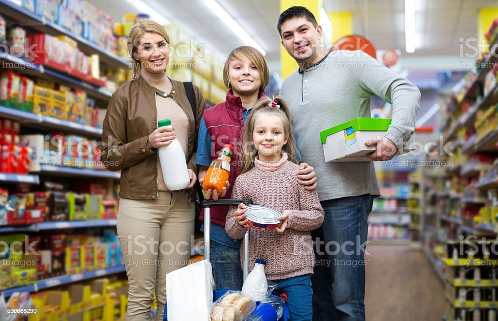 Portrait of  family with two children in local supermarket stock photo
