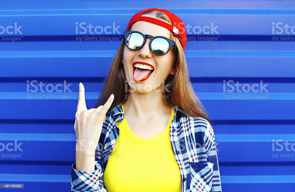 Portrait of fashion hipster cool girl in sunglasses and colorful stock photo