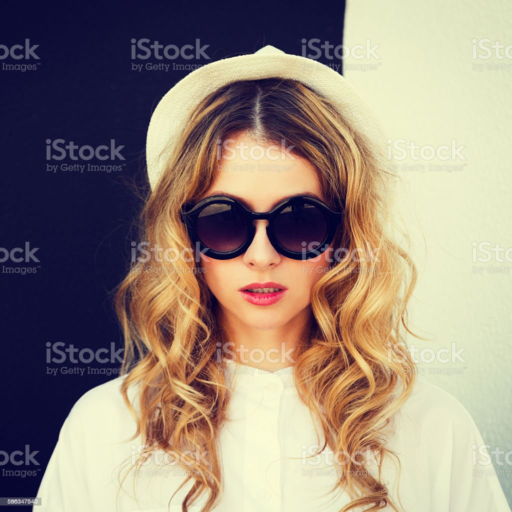 Portrait of Fashion Hipster Girl at Contrast Wall stock photo