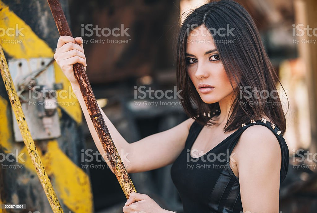 Portrait of Fashion Model Girl on the Industrial Background. stock photo
